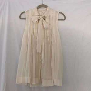 Ivory sleeveless tie-nick blouse